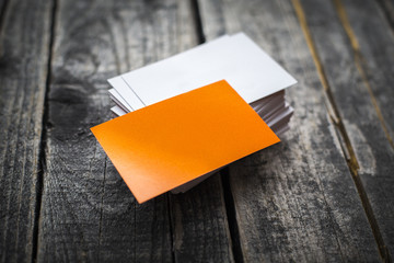 Orange business card identity mockup on wood