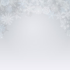 Abstract light winter background with snowflakes.