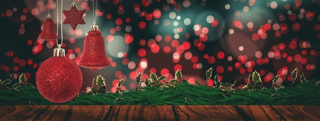 Composite image of red christmas bell decoration hanging