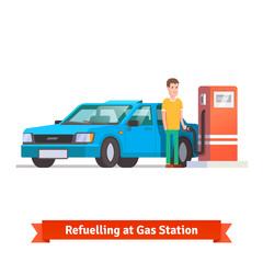 Man refuelling his car at petrol station