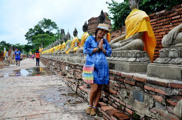 Thai woman portrait and pray in buddha statue