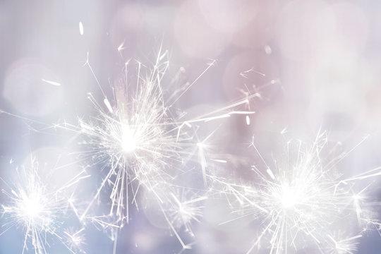 White sparkler fire for holiday festive background
