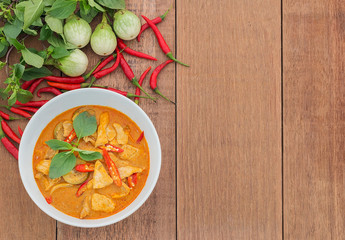 Red pork curry (Panang) with vegetable on wooden background, Tha