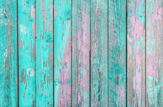 Aquamarine and purple wooden planks background -  Colorful outer fence deteriorated by time - Closeup of wood board painted surface - Fashion background with vintage color - Original colors