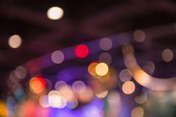 Abstract sparkling multicolor light defocused bokeh background