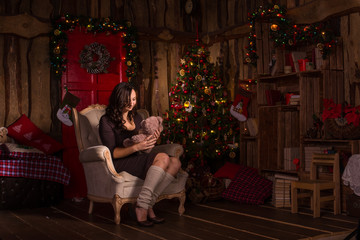 Woman with teddy bear near christmas decorations