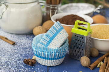 Ingredients for baking Christmas muffins on wooden background. s