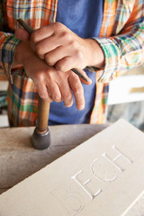Fototapete - Close Up Of Stone Mason At Work On Carving In Studio