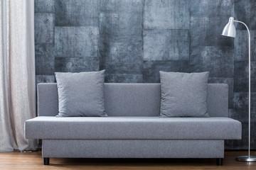 Modern sofa and concrete wallpaper