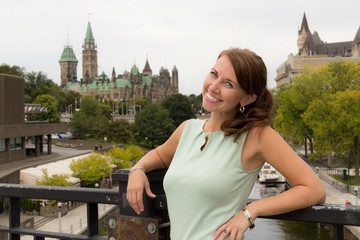 Cute casual young woman smiles in downtown Ottawa, Canada