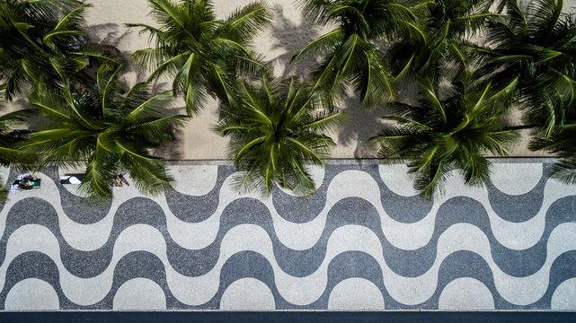 Top View of Copacabana beach with mosaic of sidewalk in Rio de Janeiro. Brazil