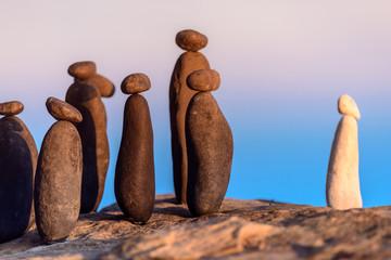 White stone confront to black group on the seashore