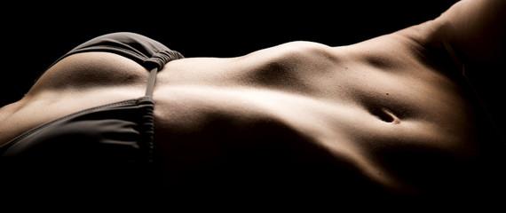 body of woman in gray bra low light