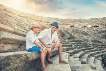 Father with son spent time together on the antique ruins
