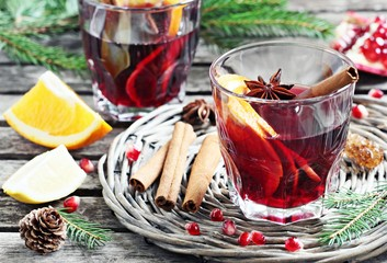 Mulled wine and spices on a rustic wooden table