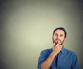 man thinking looking up