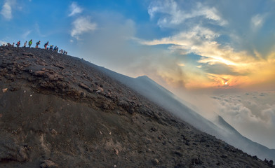 Group of tourists hiking on top of the Stromboli Volcano in the Aeolian Islands, Sicily, Italy