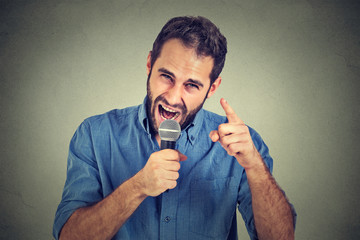 Angry man screaming in microphone