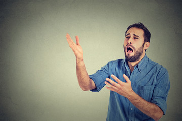 Desperate man screaming asking for help forgiveness