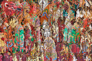 Traditional characters of balinese and javanese folk shadow puppets show - wayang kulit. Arts, indigenous crafts on Bali island and culture festivals of Indonesian people. Asian travel backgrounds.