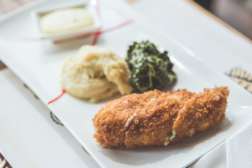 Chicken Cordon-bleu with mashed potato  and green vegetable