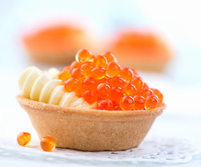 Tartlet with red caviar closeup. Gourmet food