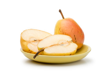 Two yellow and red juicy duchess pears in a yellow plate, isolated on white background Wall mural