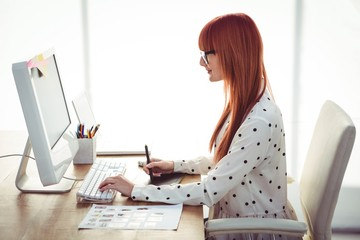 Attractive hipster woman using graphics tablet