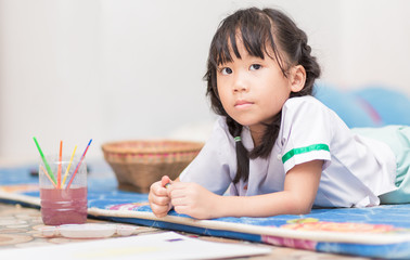 cute girl student enjoy to paint color