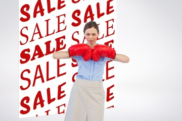 Composite image of tough woman posing with red boxing gloves