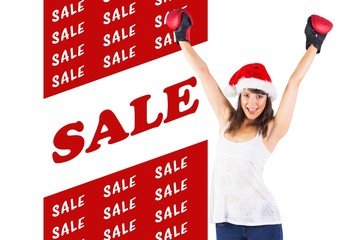 Composite image of festive brunette cheering with boxing gloves