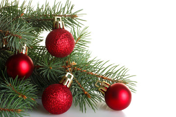 fir twigs with shiny Christmas decorations on a white isolated background
