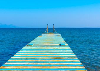 Beautiful wooden pier at a beach in kefalos area in Kos island in Greece