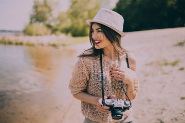 Beautiful Retro Girl With Camera