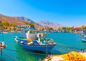 traditional fishing boats  docked at the port of Vathi village in Kalymnos island in Greece