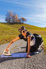 Scene housewife who irons in the road