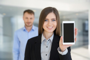 Businessman and businesswoman looking in display smartphone