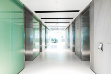 Empty hallway having elevator of business building