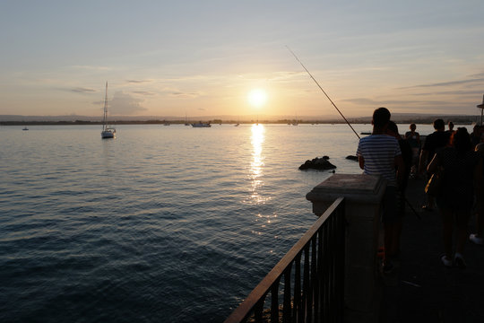 view of  a fisherman during sunset in syracuse