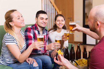 Couples hanging out with beer
