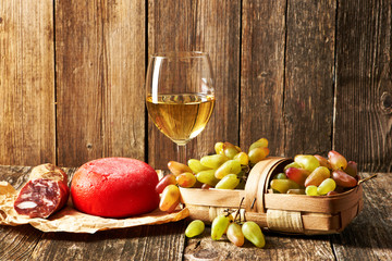 Grapes, white wine and cheese