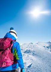 Woman on snowy mountain ridge