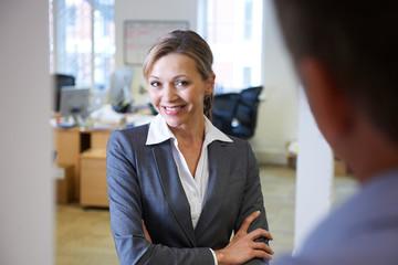 Businesswoman Being Flirtatious Towards Male Colleague