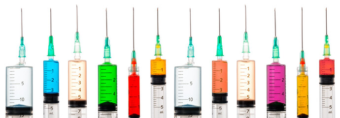 Various syringes filled with colored liquids