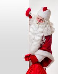 Santa Claus standing near billboard