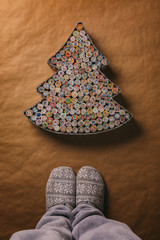 Person Standing in front of a Handmade Christmas Tree Made with