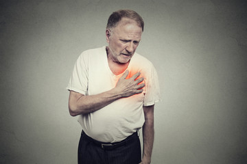 senior man suffering from bad pain in his chest heart attack