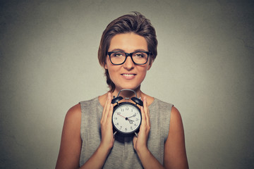 young smiling woman with alarm clock
