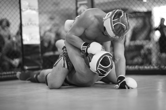 MMA fighter controlling his opponent in clinch