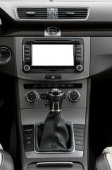 Modern car dashboard with empty white screen blank. Interior detail.
